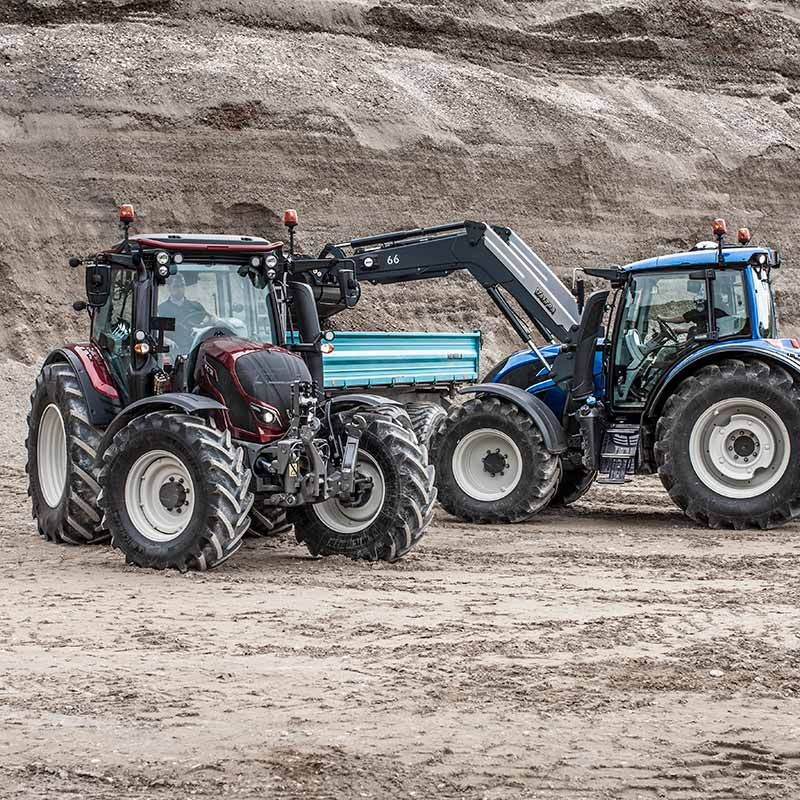 two valtra n4 series tractors working with frontloader